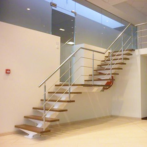 The Glass Staircase Balustrade with a stainless steel handrail system
