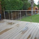 glass balustrade with metal handrail