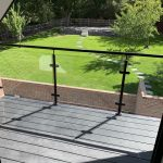 post and rail balustrade in garden with top rail